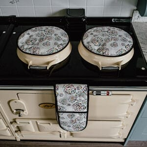 Chef Pads/Aga Pads and Oven Glove on display on Aga Cooker Dandi Design