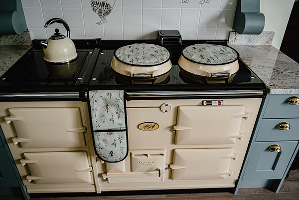 Its a Bugs Life design Oven Glove and Aga Pads/Chef Pads on display on an Aga Cooker